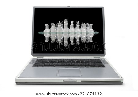 Laptop Concept - Competition reflected in the chess pieces - stock photo