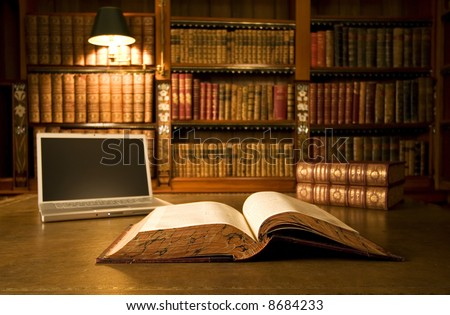 Laptop in classic library with books in background series - stock photo