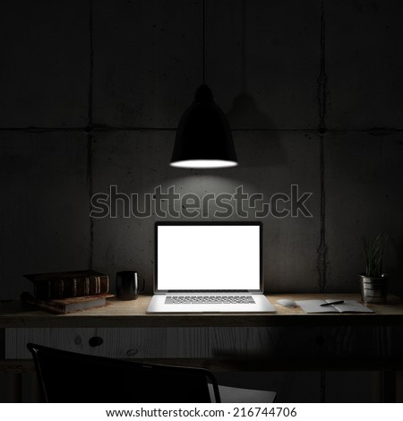 Laptop in night room - stock photo