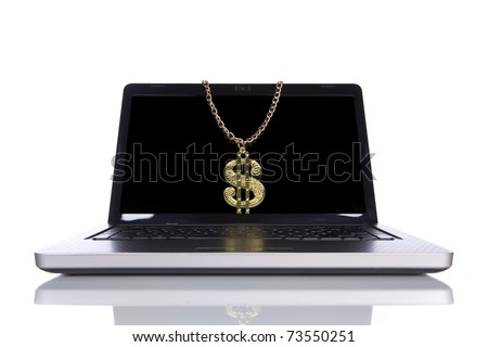 laptop isolated on white with a golden dollar symbol (selective focus) - stock photo