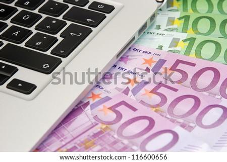 laptop keyboard and money - stock photo