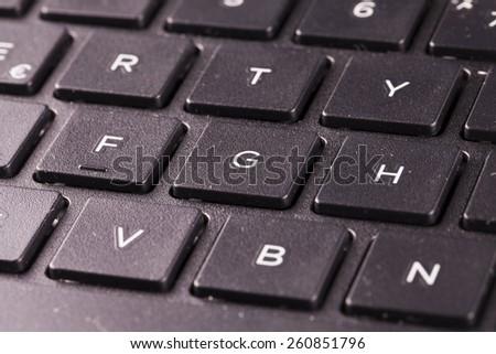 Laptop keyboard in close up, horizontal image - stock photo