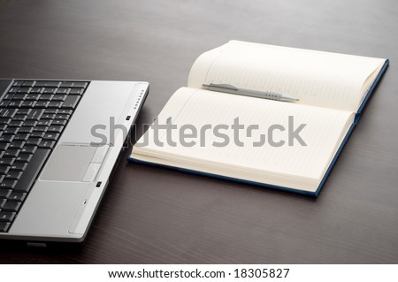 Laptop keyboard,notepad and pencil on office desk