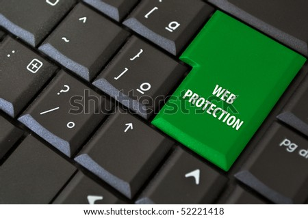 laptop keyboard with a black button access to the Internet with protection - stock photo