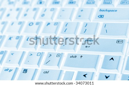 Laptop keyboard with blue tint - stock photo