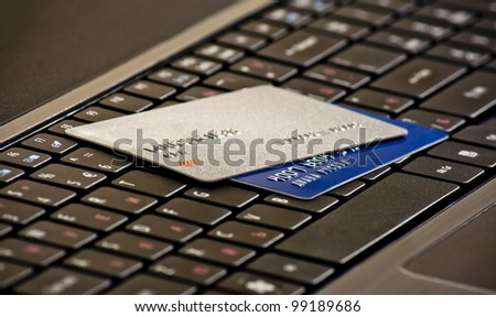 Laptop keyboard with credit cards, selective focus - stock photo