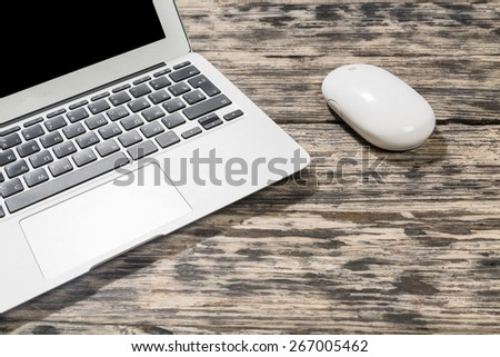 Laptop. Laptop computer on a wooden desk. Top view. great for your copy space - stock photo