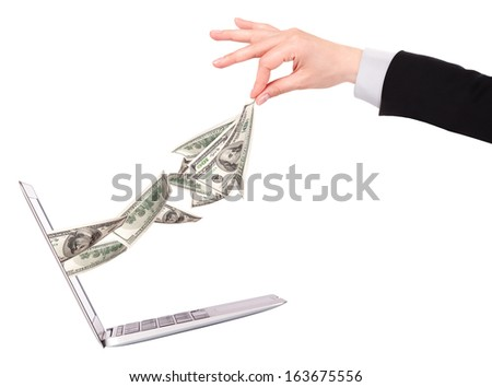 Laptop making money concept isolated on a white background - stock photo