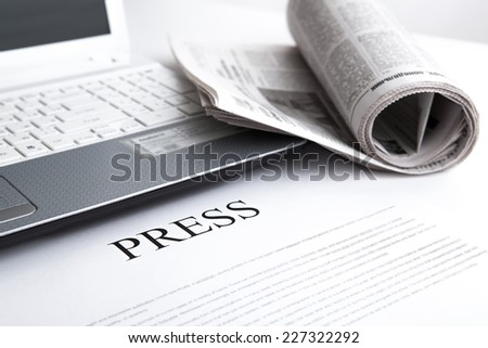 laptop, newspaper office and text press - stock photo