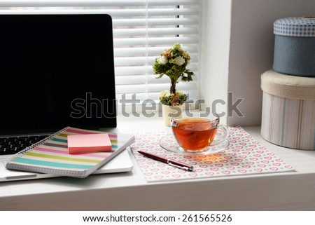 Laptop, notebook on windowsill. Working place concept - stock photo
