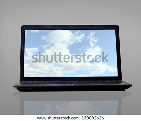Laptop (notebook) with sky desktop wallpapers - stock photo