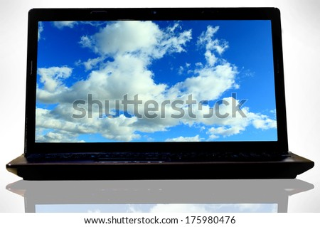 Laptop (notebook) with sky desktop wallpapers - stock photo