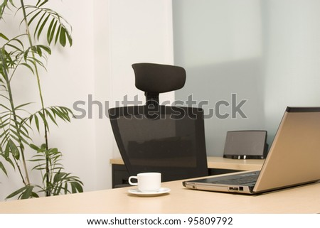 laptop on a desk at modern office - stock photo