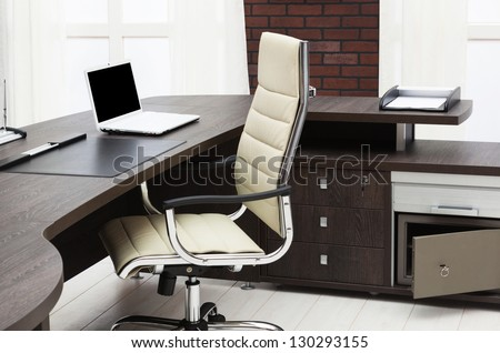 laptop on a desk in a modern office