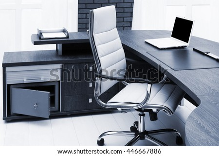 laptop on a desk in a modern office - stock photo