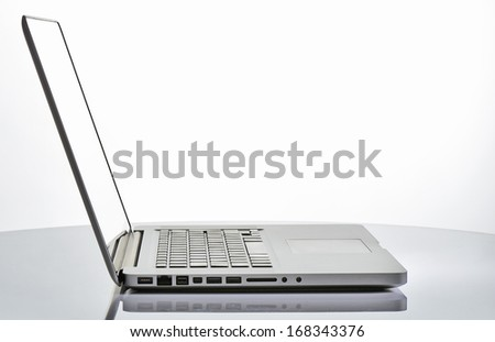 laptop on a table - stock photo