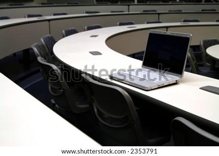 laptop on curved desk - stock photo
