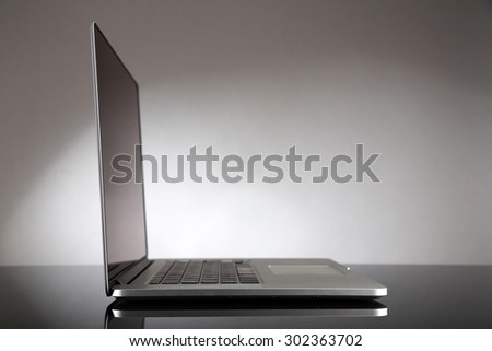 Laptop on gray background - stock photo