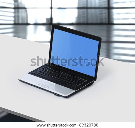 laptop on office desk - stock photo
