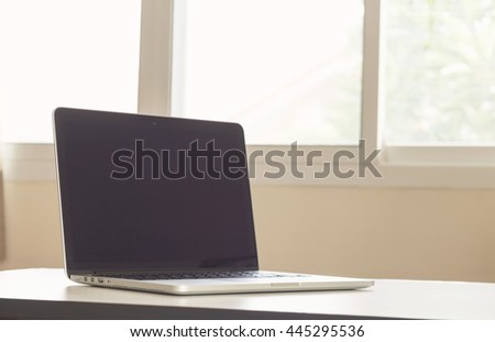Laptop on office desk - vintage effect style pictures
