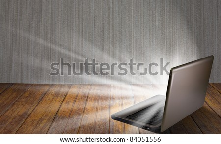 laptop on table with light out - stock photo