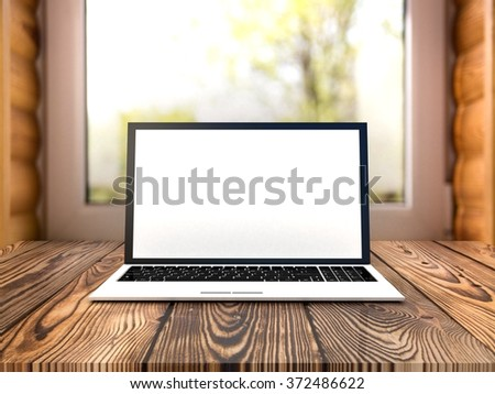 Laptop on window background - stock photo