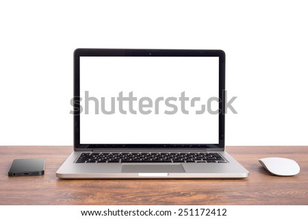 Laptop on wooden table notebook and phone - stock photo