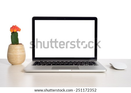Laptop on wooden table notebook and red flower - stock photo