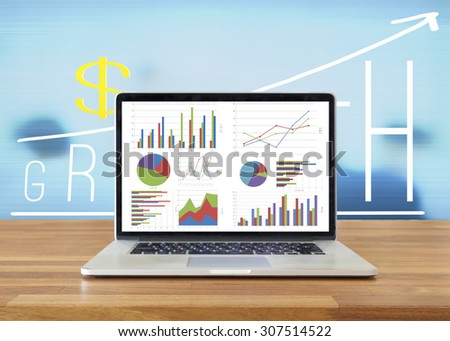 Laptop on wooden table showing charts and graph, Analysis Business Accounting,  Statistics Concept. - stock photo