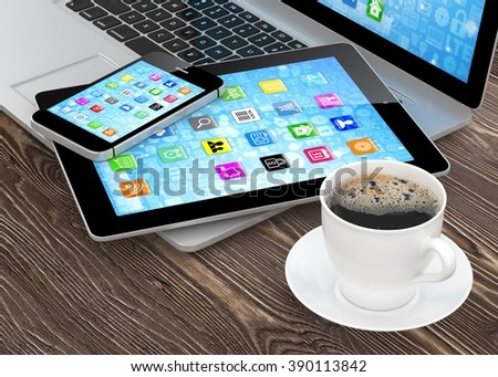 Laptop, phone, tablet pc and coffee. - stock photo