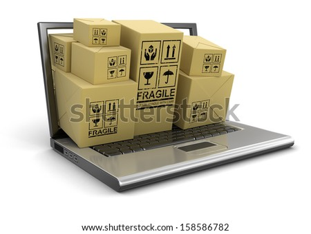 Laptop, Shopping Basket and packages (clipping path included) - stock photo