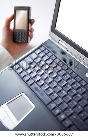 Laptop & smart phone - shallow dof - stock photo