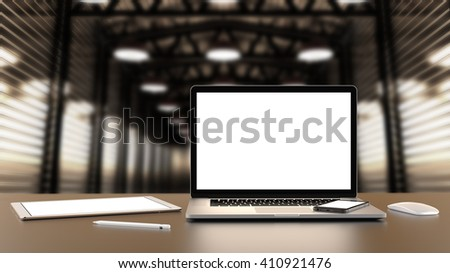 Laptop, tablet, smartphone, mouse,and pencil on the factory hall warehouse with blank screen on table, notebook a rectangular screen for inserting images, high detailed,realistic. 3D rendering.  - stock photo