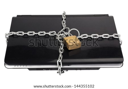 Laptop tied with chain and a padlock - stock photo