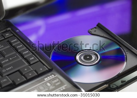 Laptop with a disk dvd. - stock photo