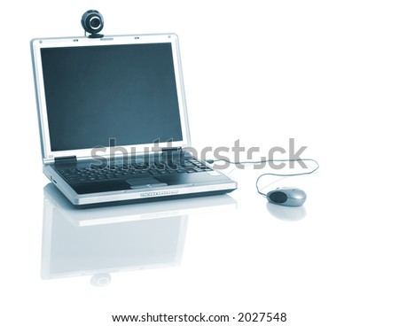 Laptop with a webcam over the table with reflection - stock photo