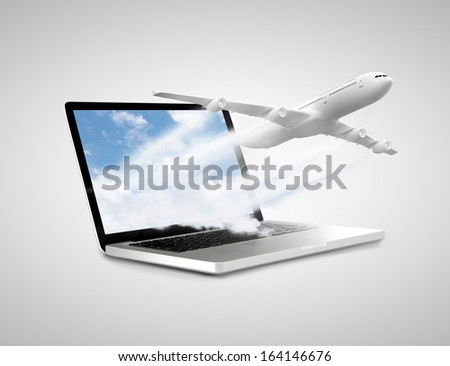 laptop with airplane on a white background - stock photo