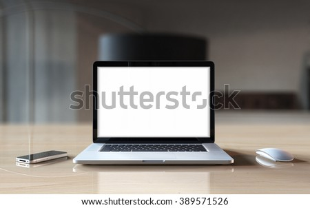 Laptop with blank screen on table. - stock photo