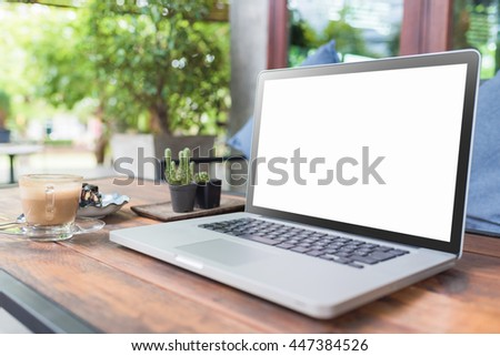 Laptop with blank screen on wood table. gray color laptop white screen and smartphone and coffee cup in cafe.   - stock photo