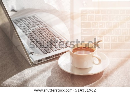 Laptop with coffee cup home office.