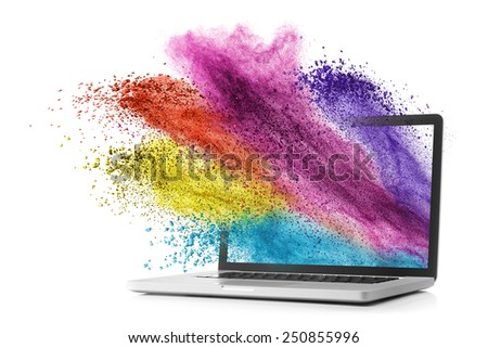 Laptop with color splash isolated on white background - stock photo
