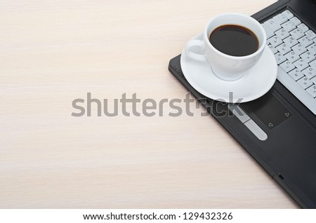 laptop with fresh cup of coffee and notebook - stock photo