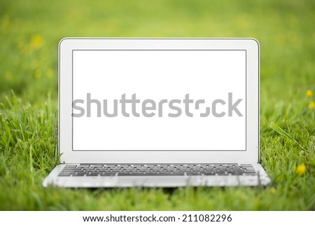 Laptop with grass - stock photo