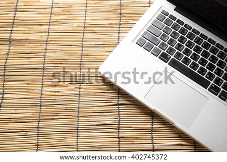 laptop with isolated screen on old wooden desk - stock photo