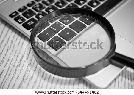 Laptop With Magnifying Glass.Close up