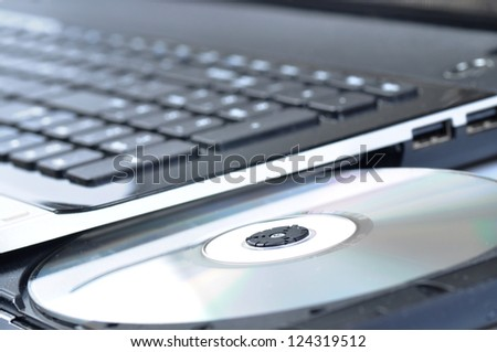 Laptop with open CD - DVD drive - stock photo