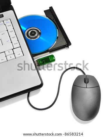 laptop with open compact disc tray,USB flash drive and mouse - stock photo