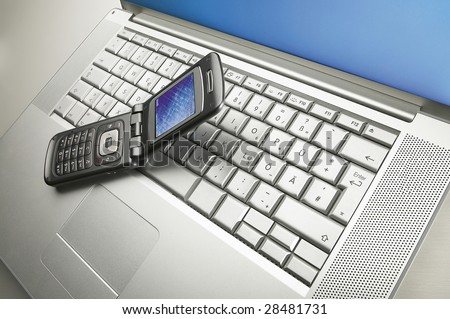 laptop with phone - stock photo