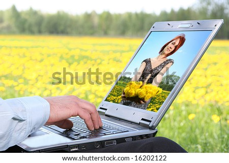laptop with picture of beautiful girl on desktop