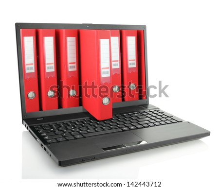 Laptop with red ring binders - stock photo
